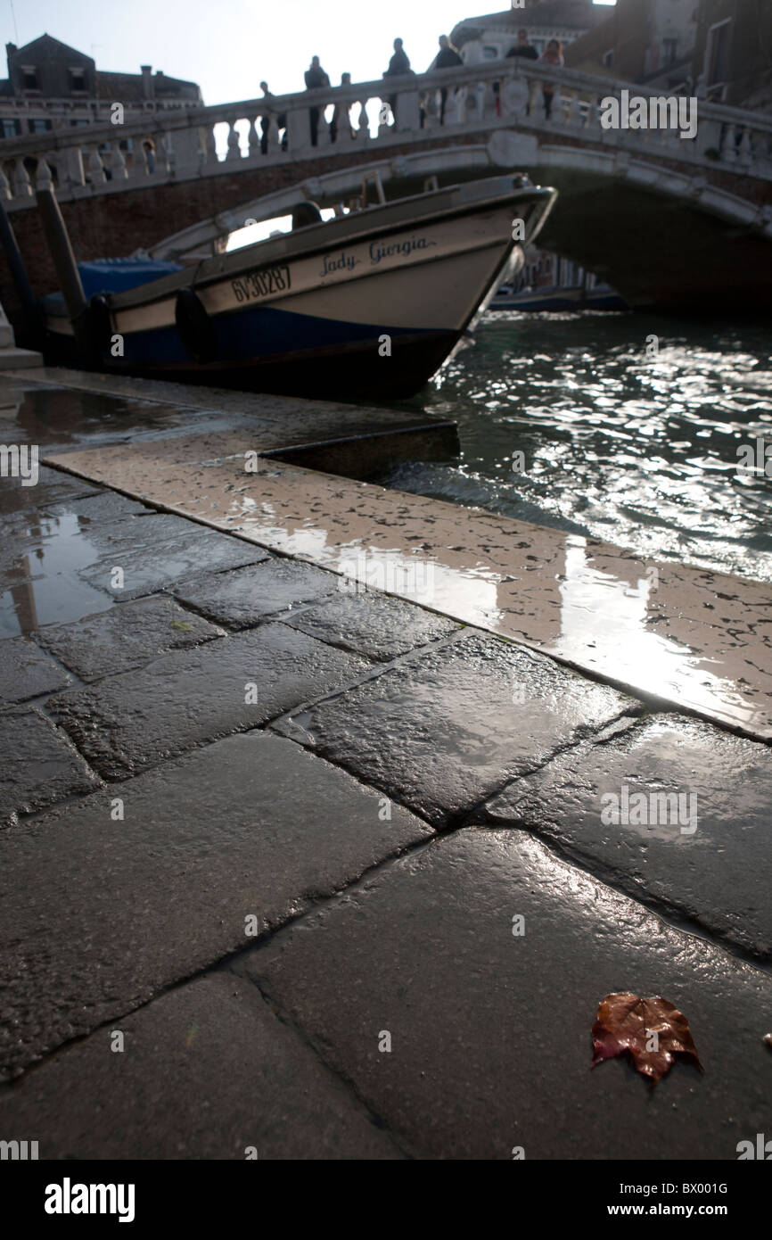 A scene by a canal in the Cannaregio district of Venice in autumn. - Stock Image