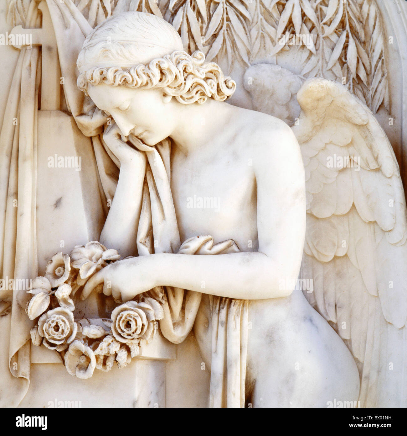 angel Europe marble sculpture grief roses symbol Stock Photo