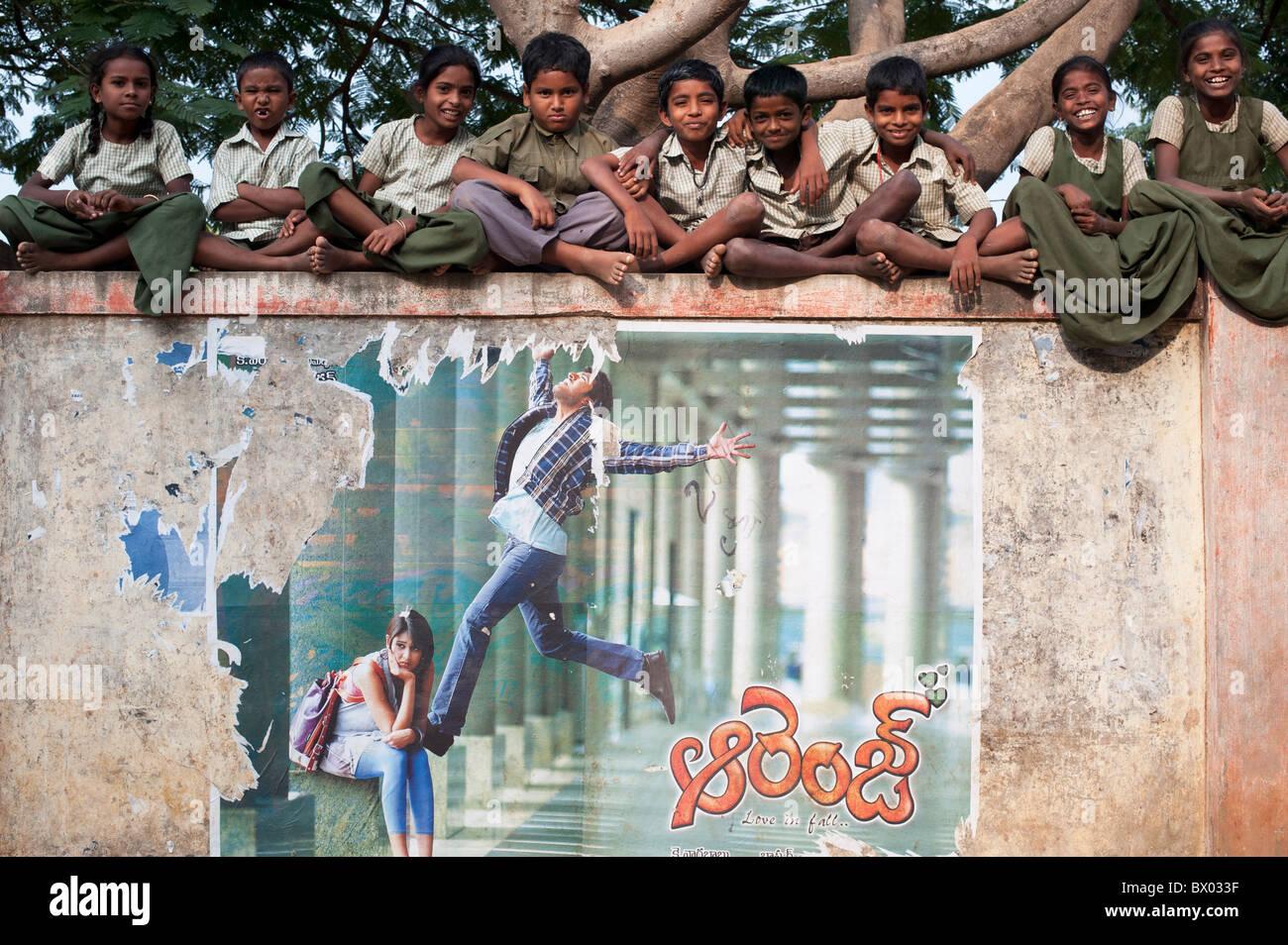 Rural Indian village school children sitting on their school wall. Andhra Pradesh, India Stock Photo
