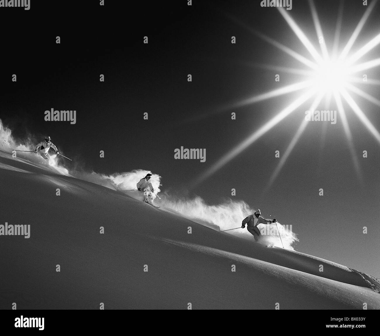 mountains Carving ski group monochrome snow black and white ski skiing sun sport deep snow deep snow dri - Stock Image