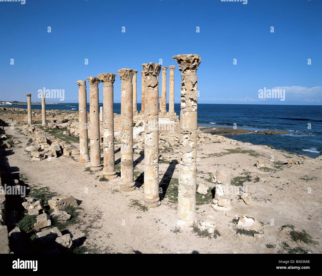 antique Ancient world antiquity historical Isis temple coast Libya sea ruins Sabratha columns UNESCO wor - Stock Image