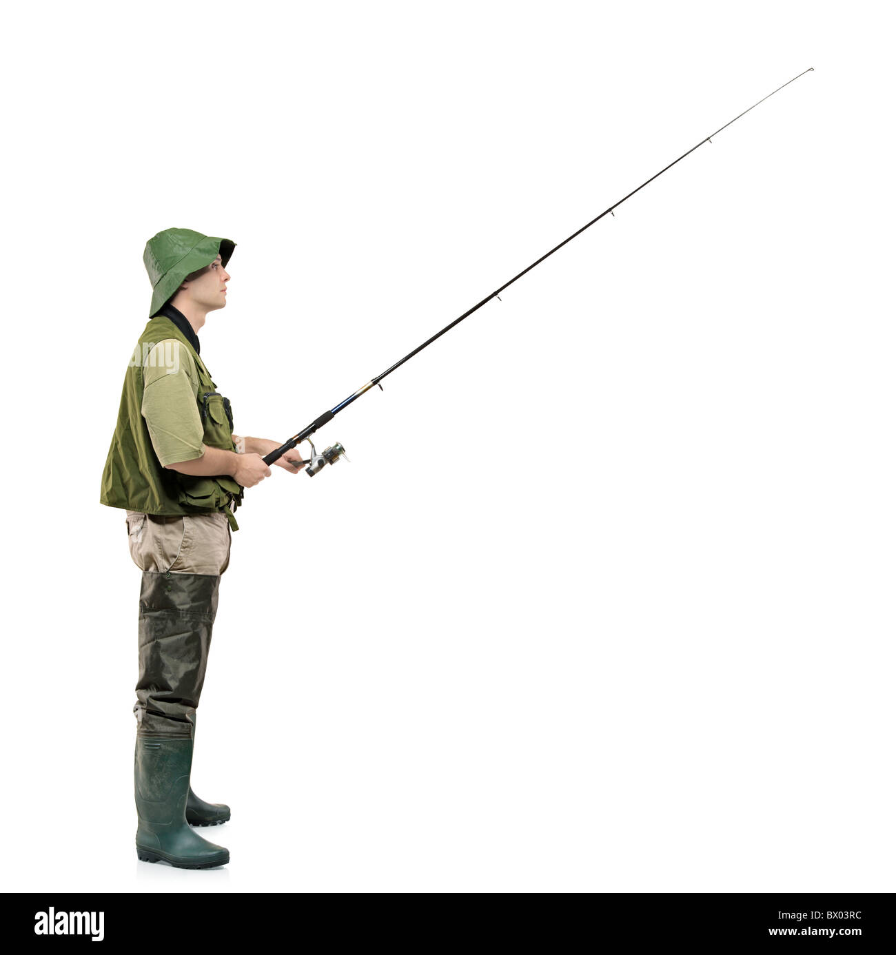 A full length portrait of a fisherman holding a fishing pole - Stock Image
