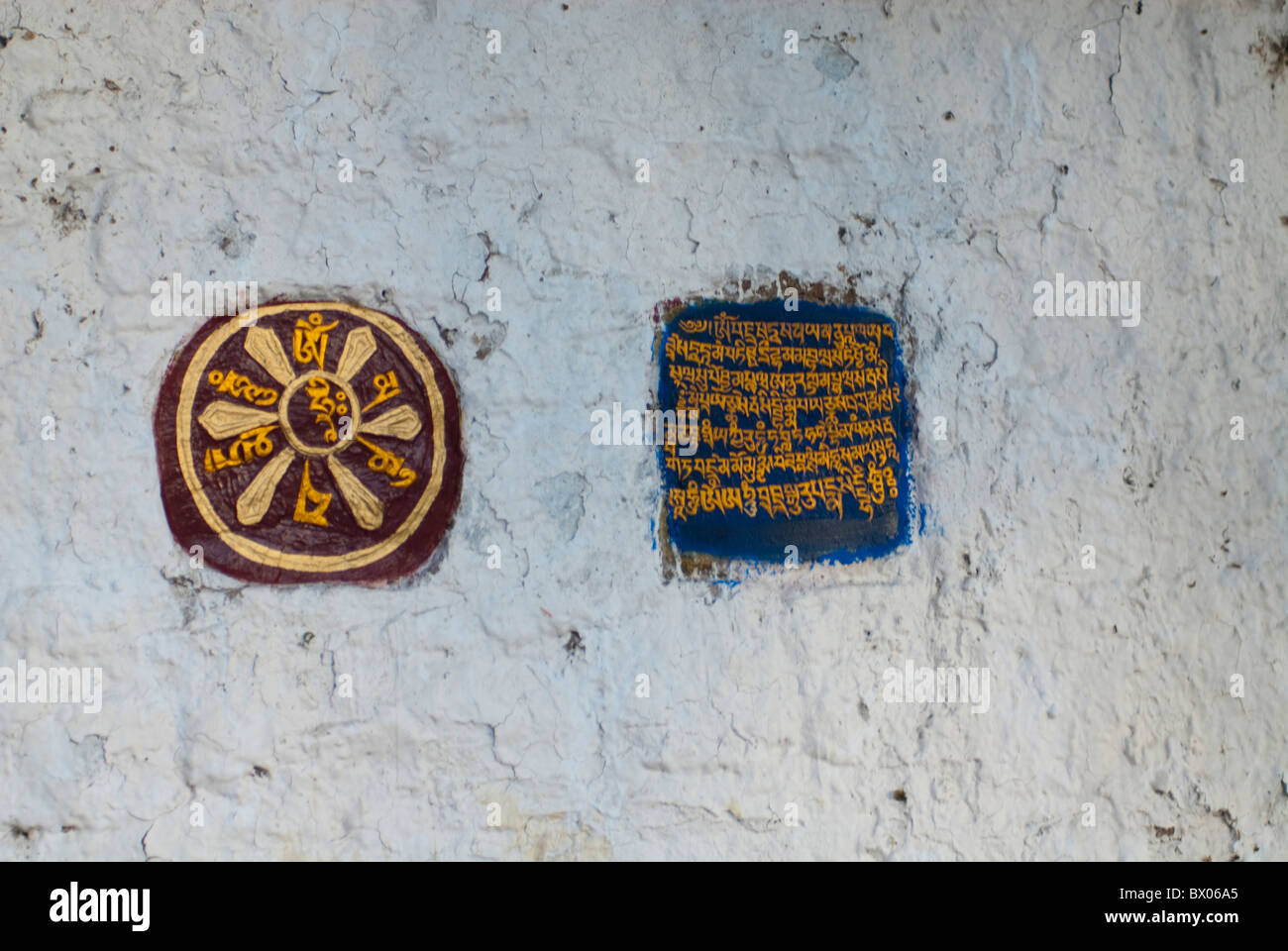 White washed wall decorated with wheel and scripture, Potala Palace, Lhasa, Tibet, China - Stock Image