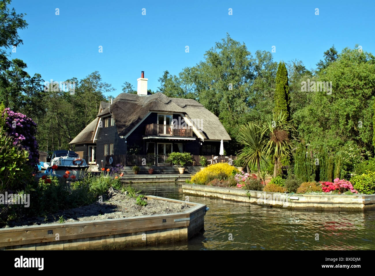 waterside property on the norfolk broads - Stock Image