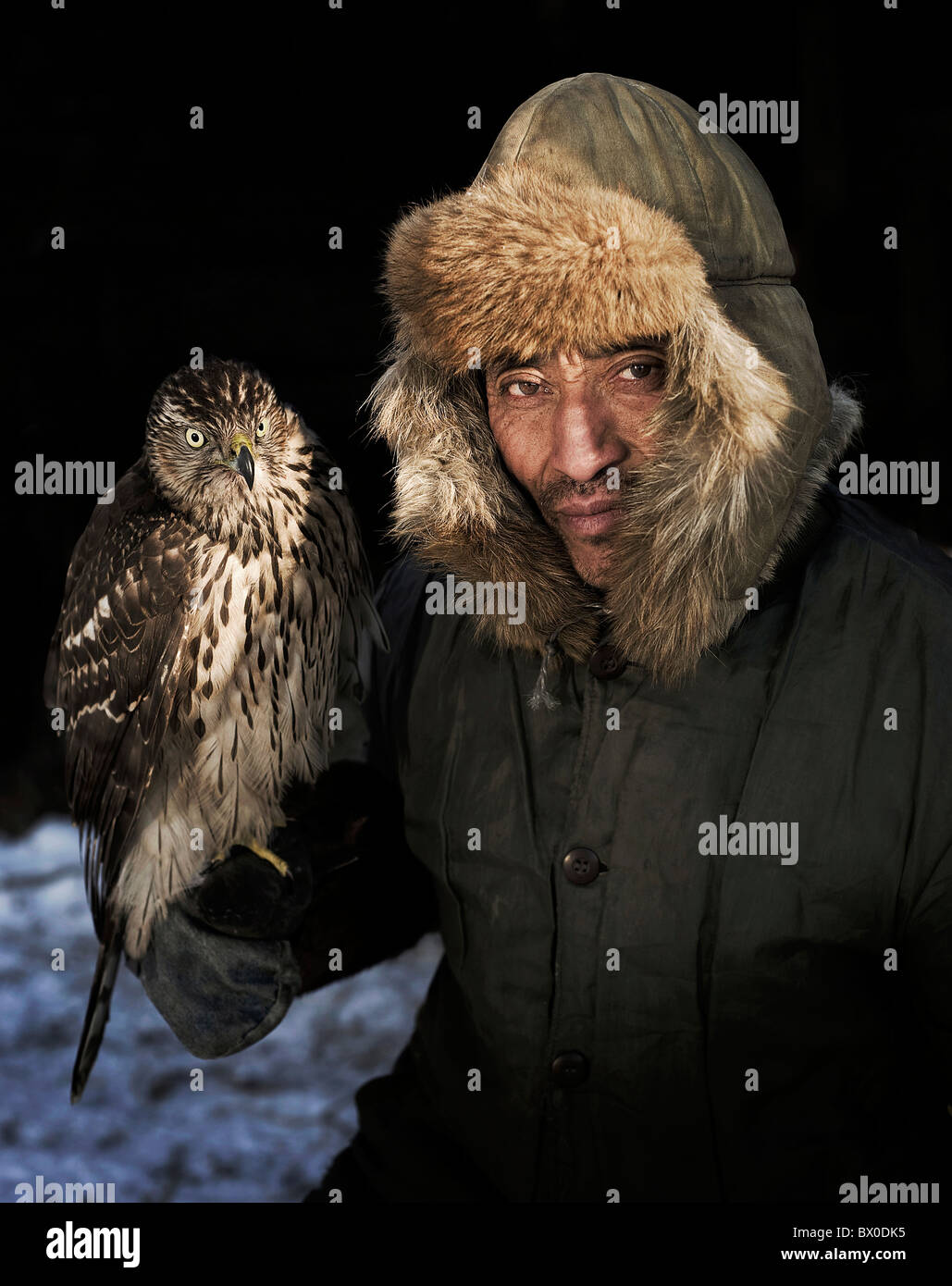 manchurian-hunter-with-his-gyrfalcon-eag