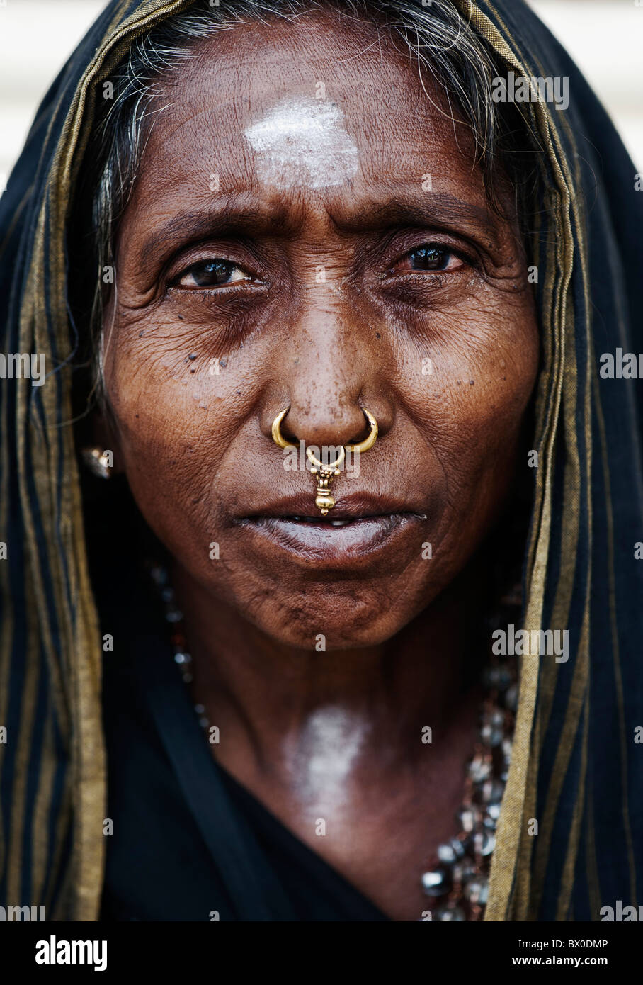 Old Indian woman on Ayappa pilgrimage in Puttaparthi, Andhra Pradesh, India Stock Photo