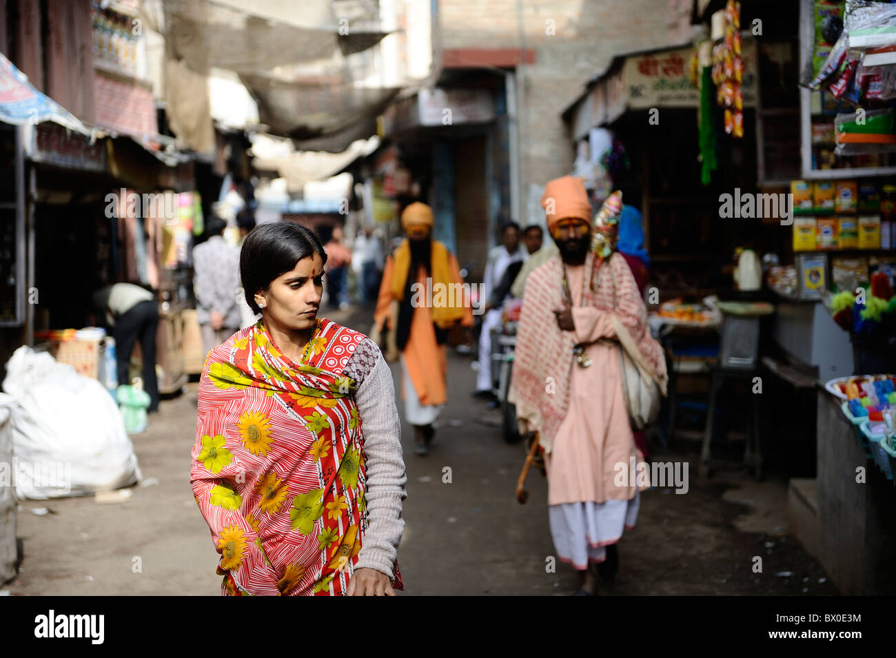 Two sadhus and a girl roam in the street of Bikaner; Rajasthan, India. - Stock Image