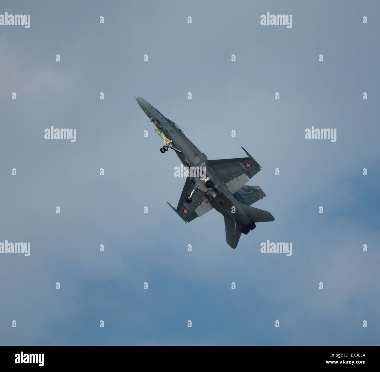 Swiss F/A-18C Hornet  climbing steeply into sky showing undercarriage under side - Stock Image