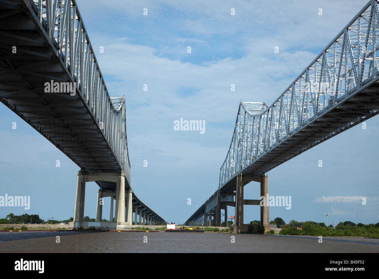 The Crescent City Connection (formerly the Greater New Orleans Bridge) are twin cantilever bridges spanning the - Stock Image