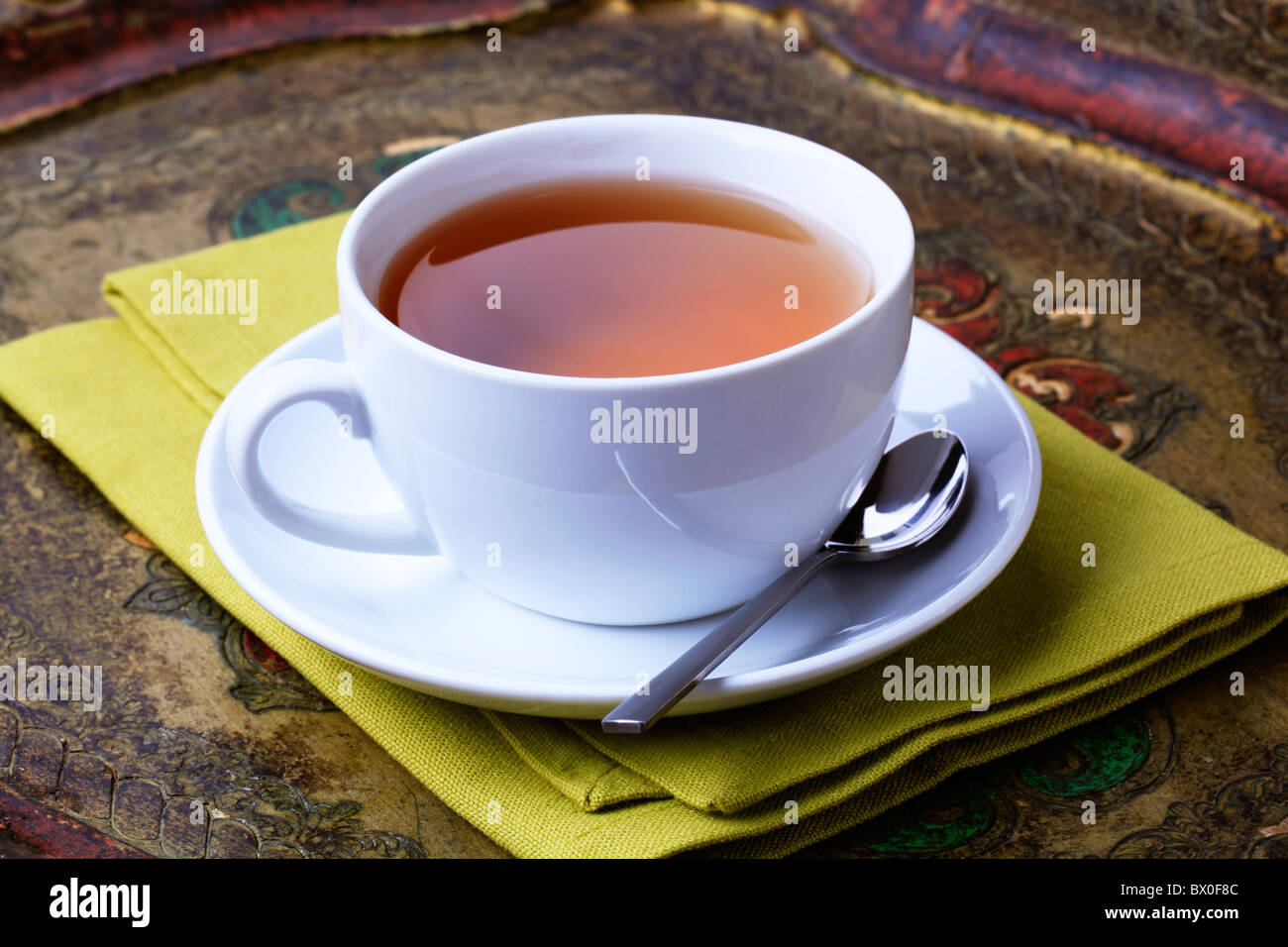 Cup of black tea on an antique tray - Stock Image