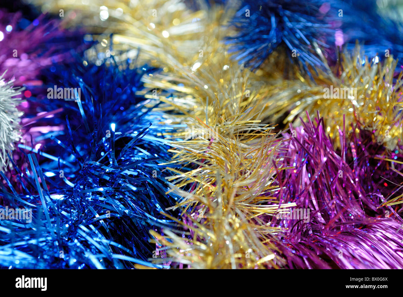 Multicolored tinsel background - Stock Image