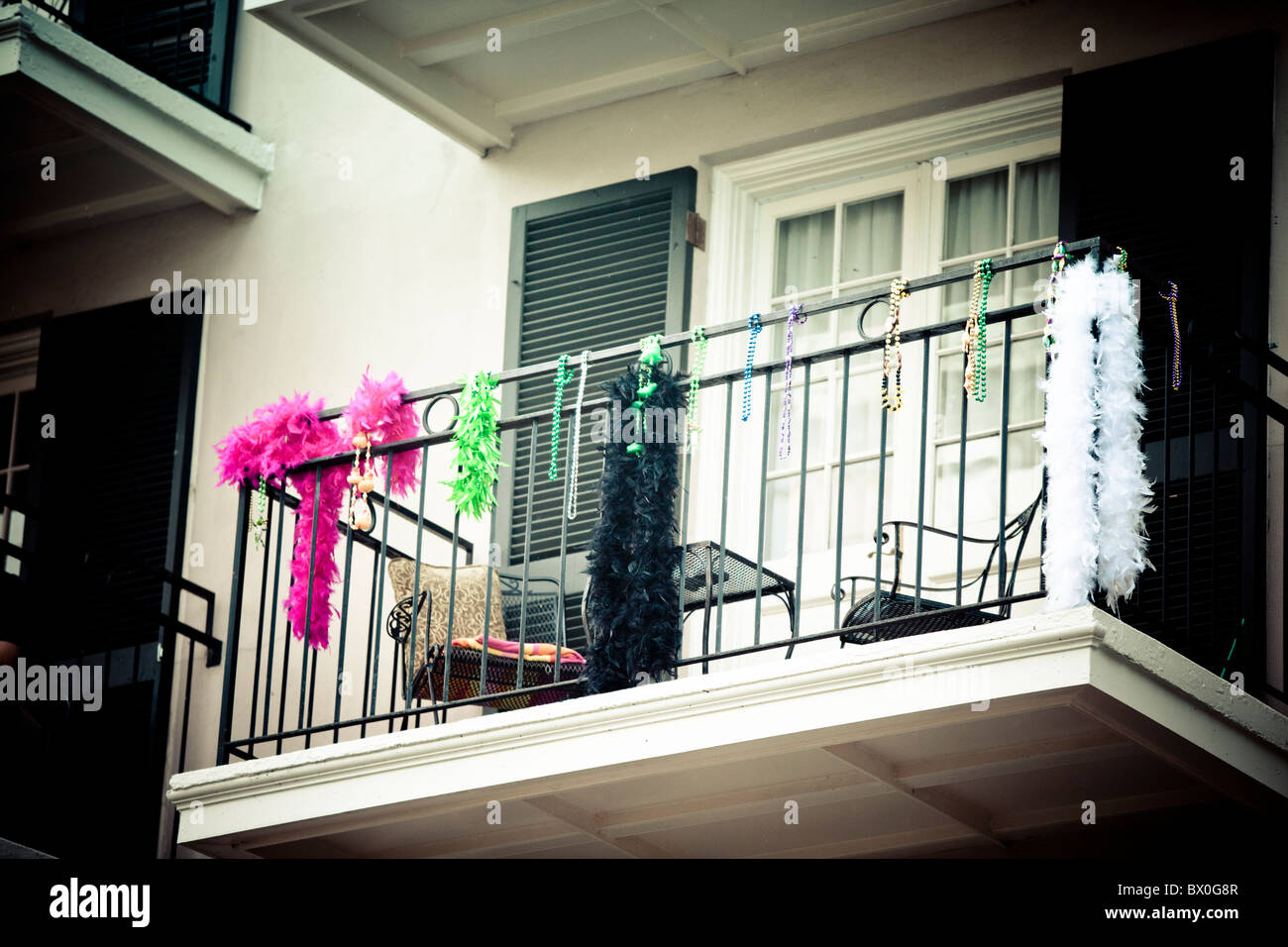 Mardi Gras beads decorate a balcony on Bourbon Street in New Orleans, Louisiana's French Quarter. - Stock Image