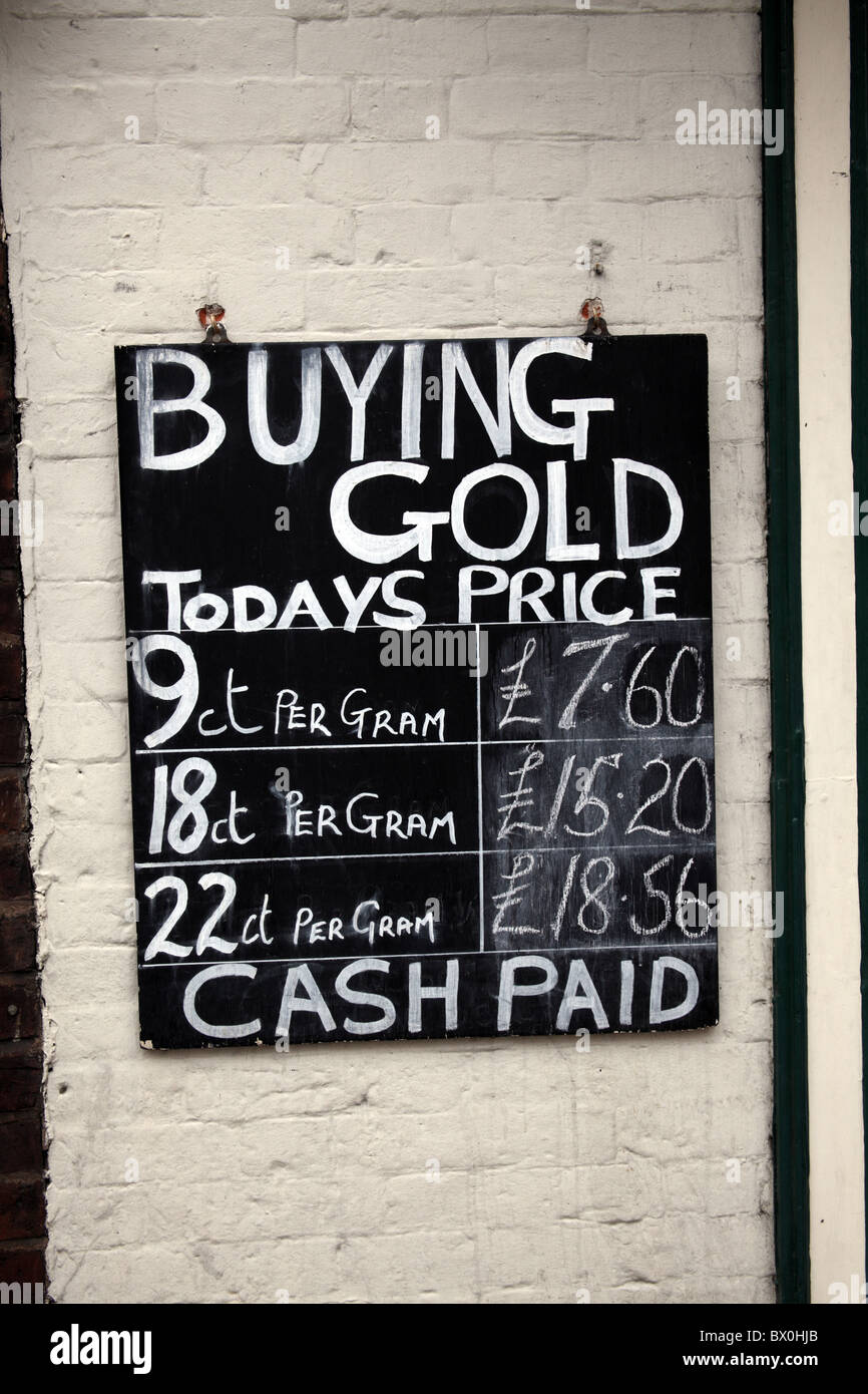 Sign outside jewellry shop listing gold prices - Stock Image