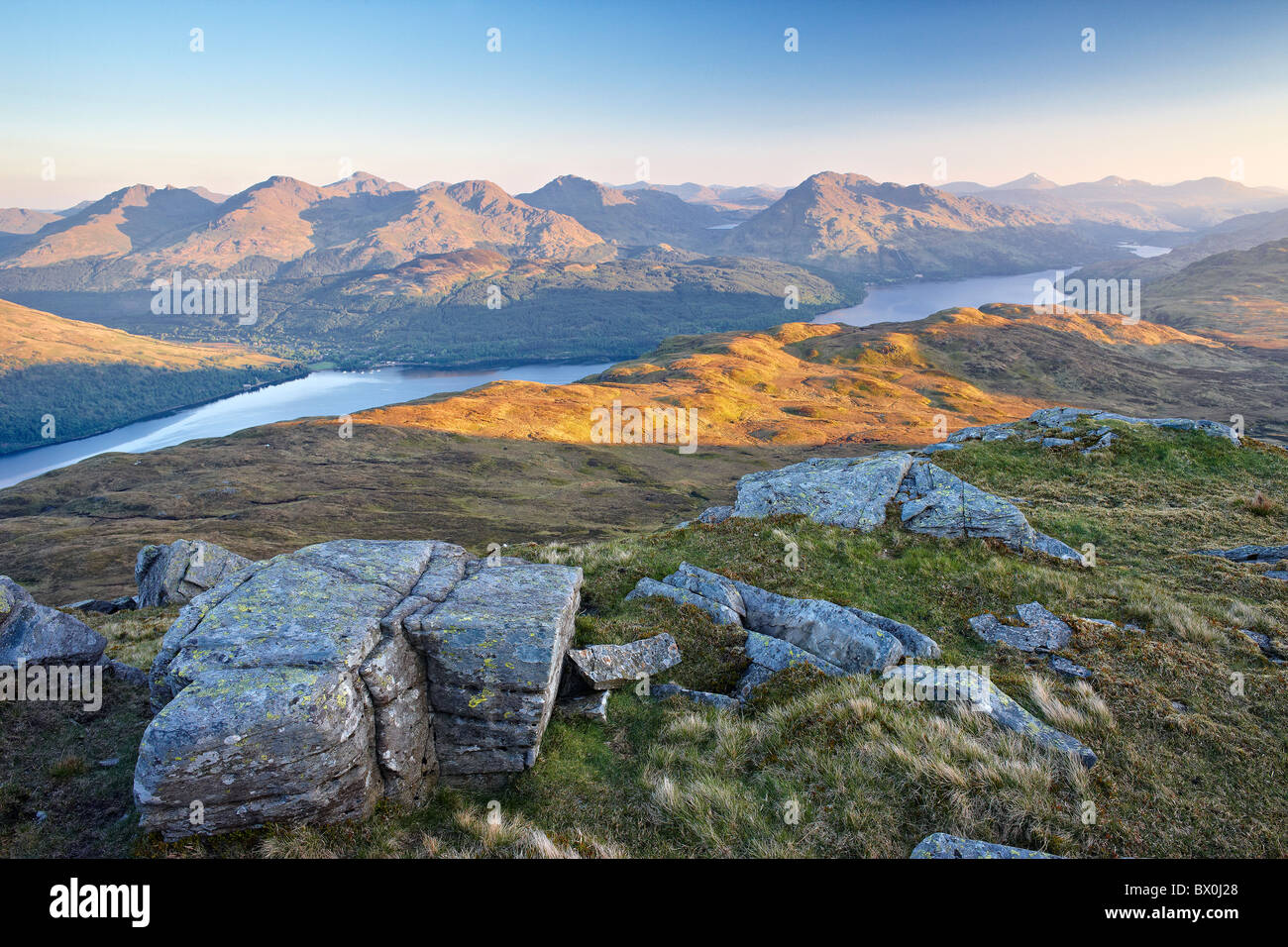 Daybreak on Loch Lomond and the Arrochar Alps from near the summit of Ben Lomond in the southern highlands of Scotland - Stock Image