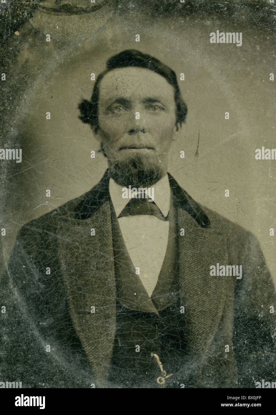 1860s man with beard coat jacket fashion portrait black and white tin type photograph vertical american americana - Stock Image