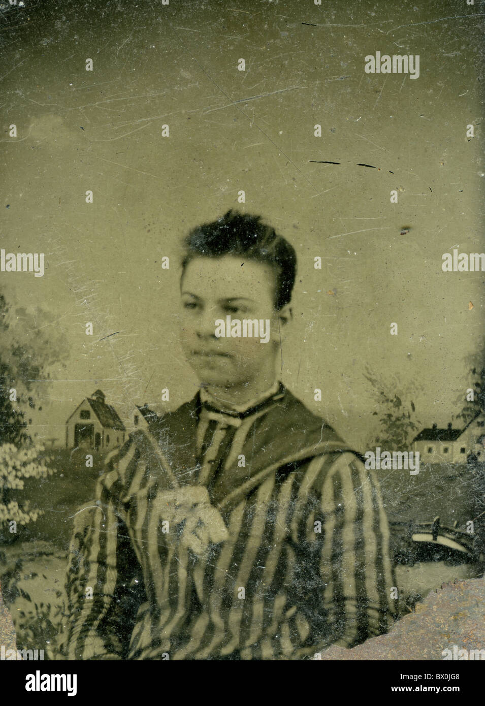 woman with pin striped jacket 1860s 1870s black and white tin type photograph - Stock Image