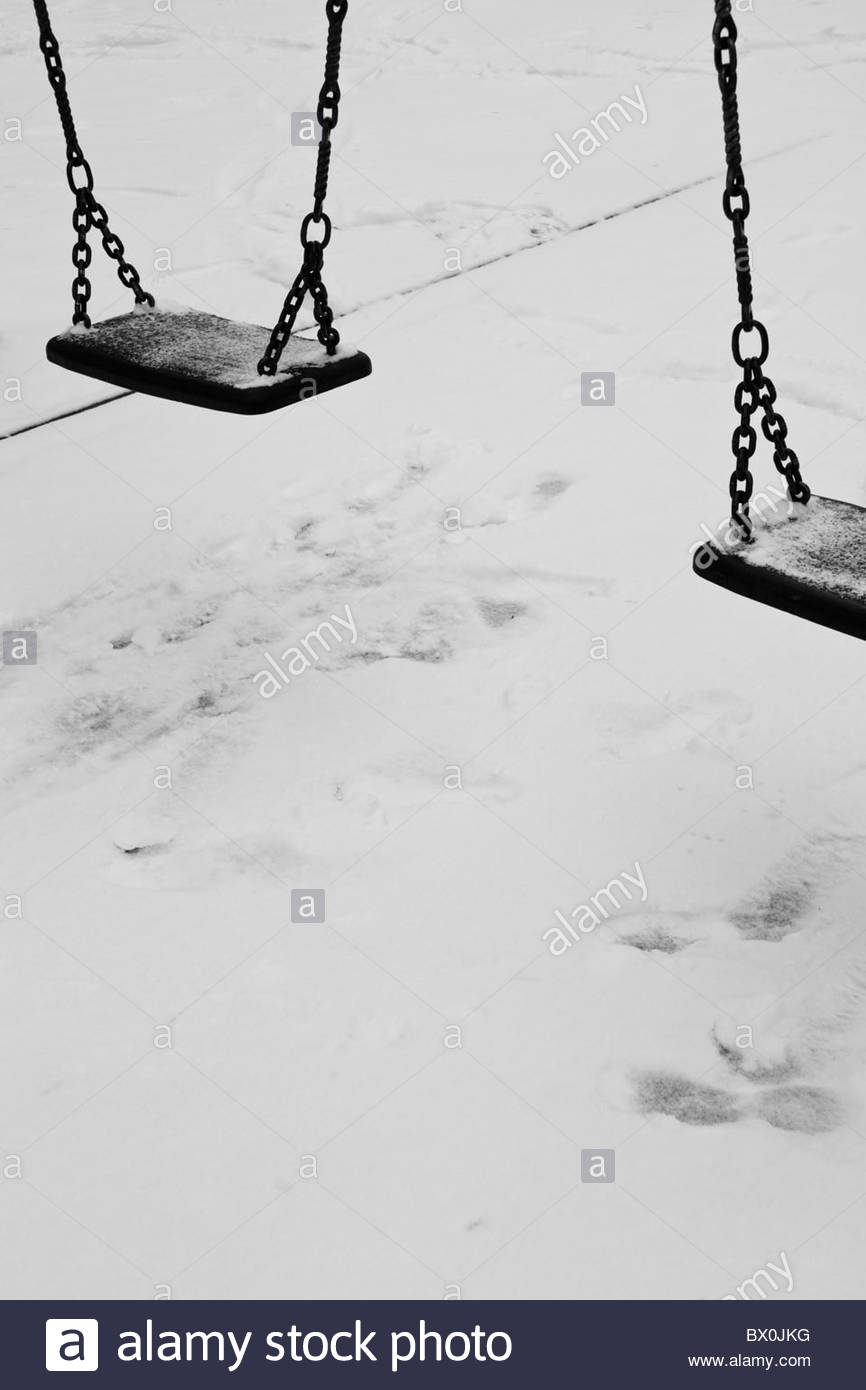 Swings And Snow Black And White - Stock Image