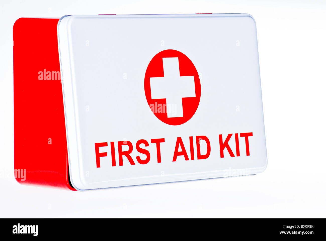 First aid kit box over white background - Stock Image