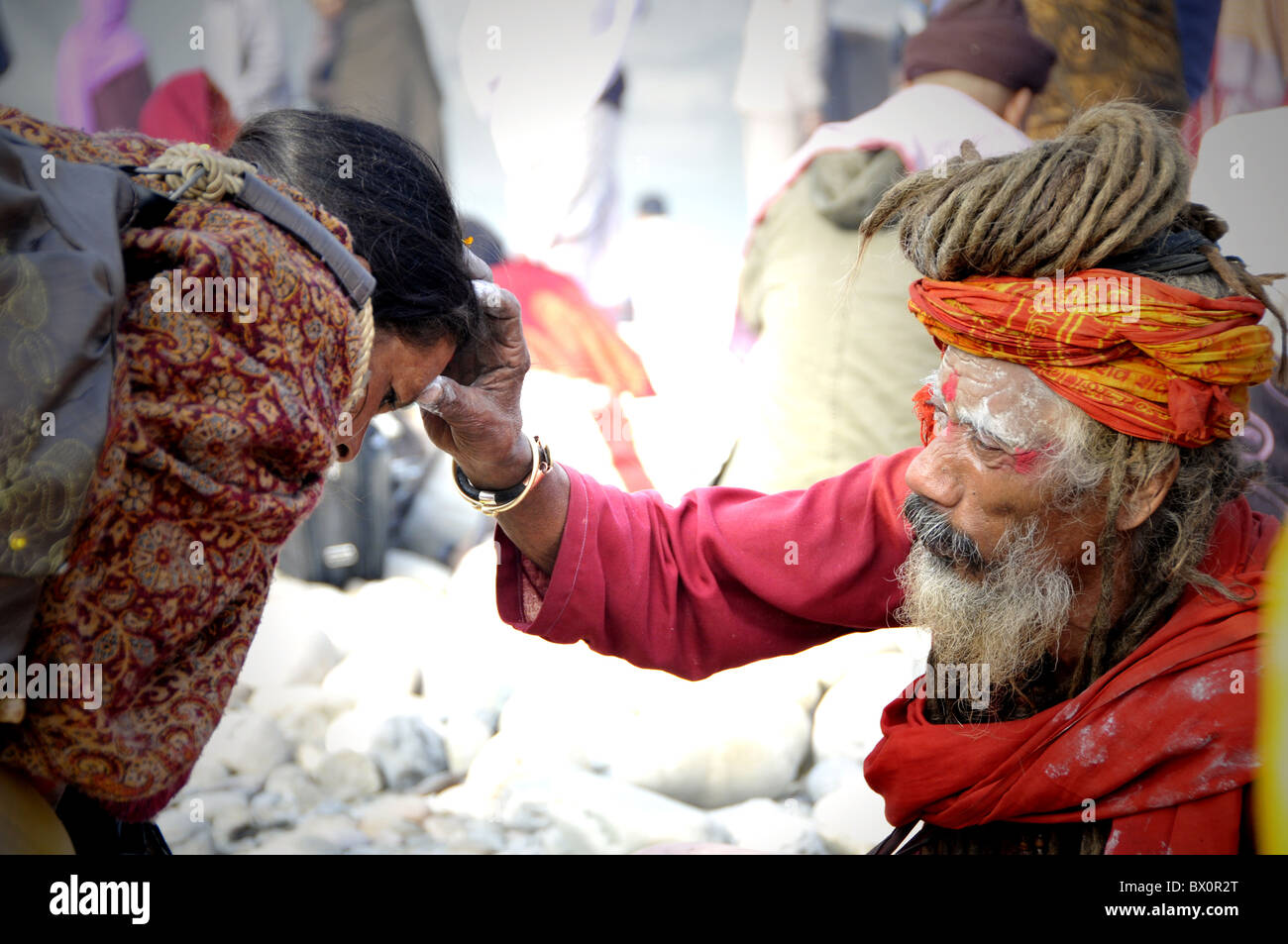 sadhu giving the blessing to a pilgrim - Stock Image