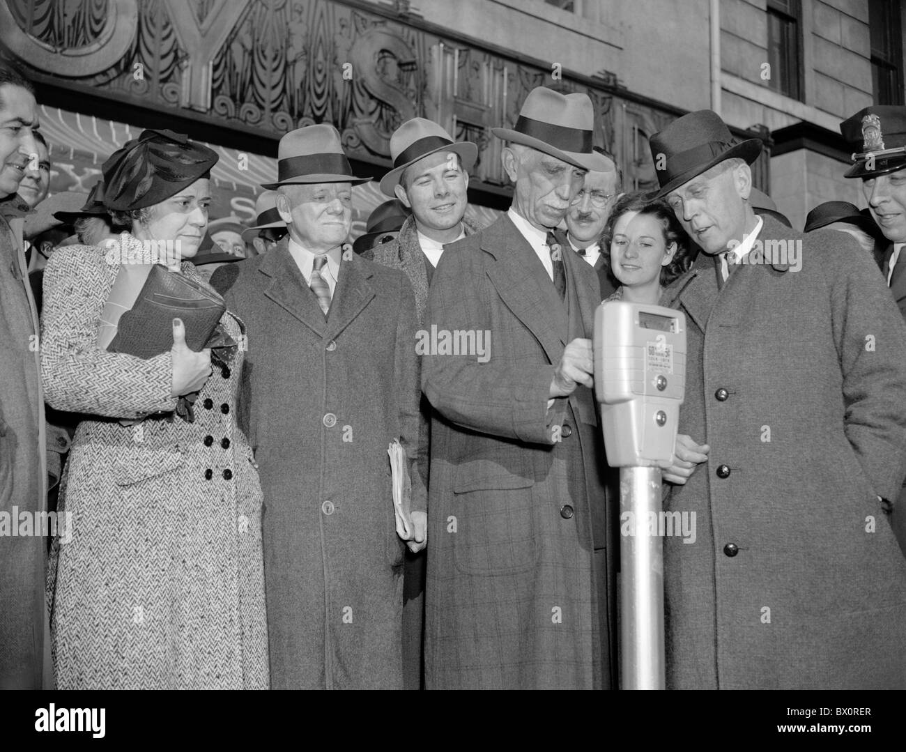 Vintage photo taken in 1938 of a crowd watching as the first nickel is inserted into new parking meters in Washington - Stock Image