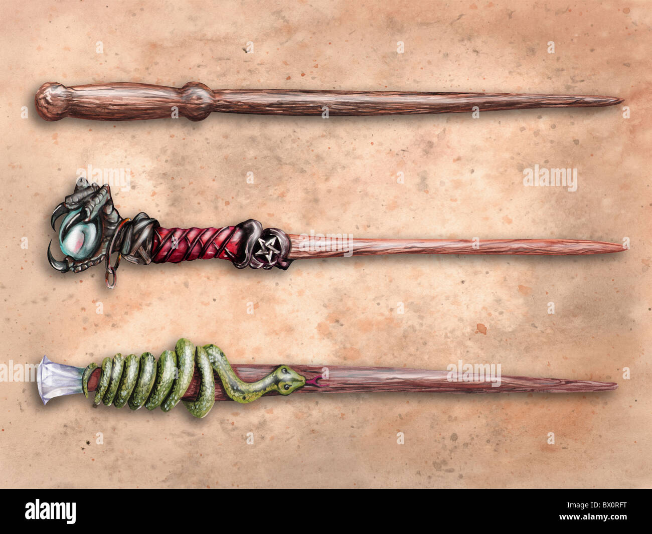 Three magical wizard wands on old parchment - Stock Image