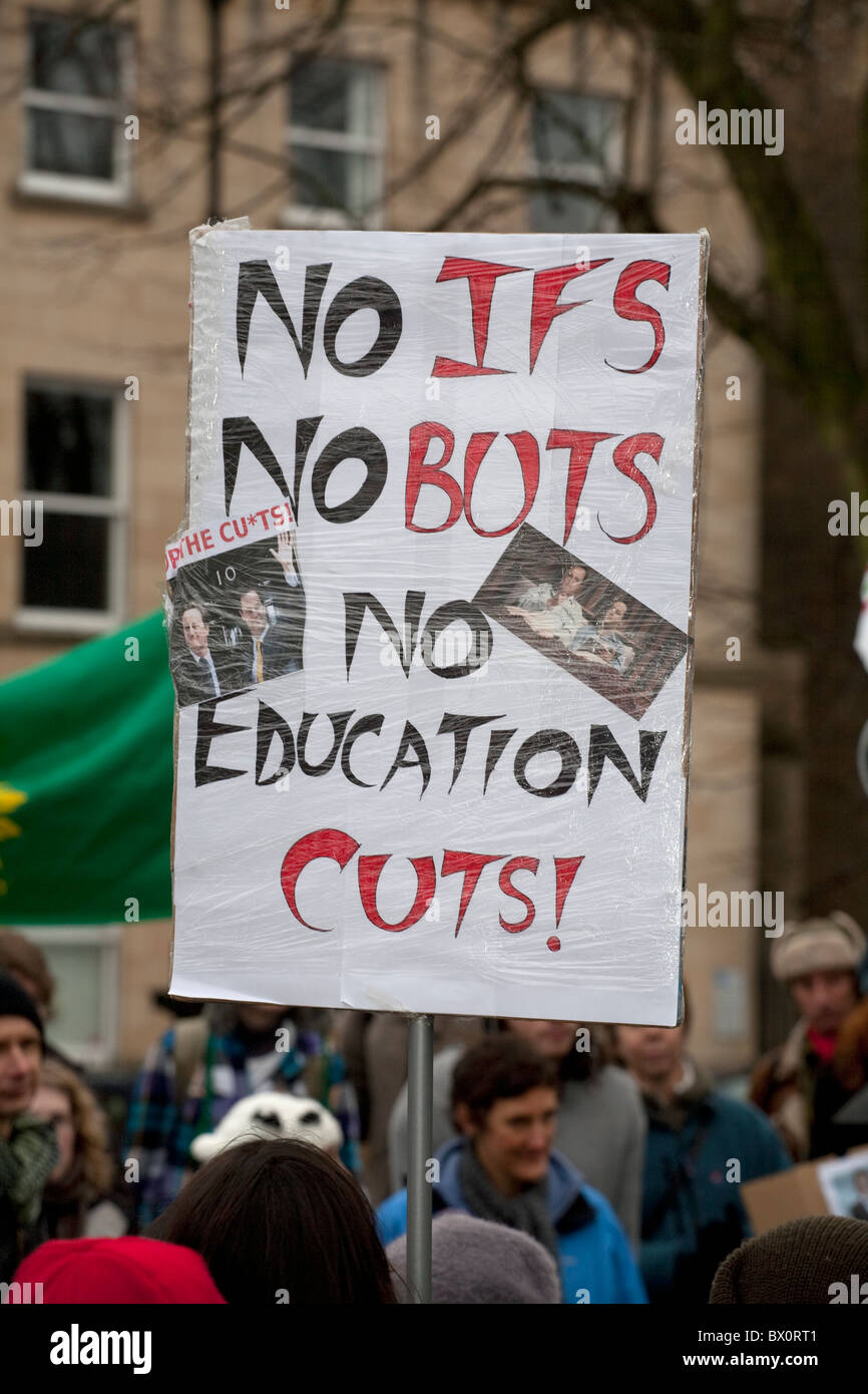 Placards and protesters during a protest against education cuts by the coalition government held by students in - Stock Image