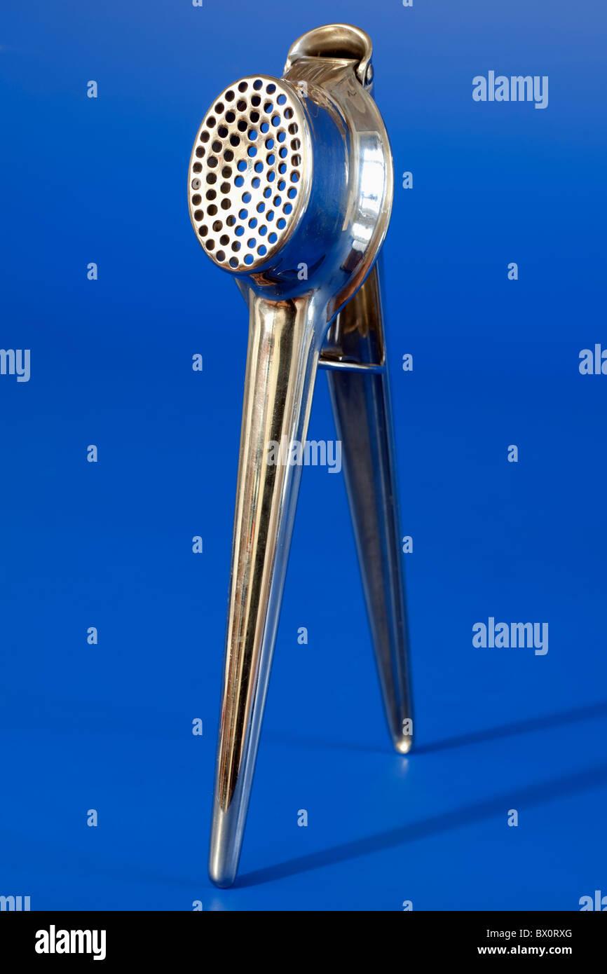 Terence Conran stainless steel garlic crusher - Stock Image