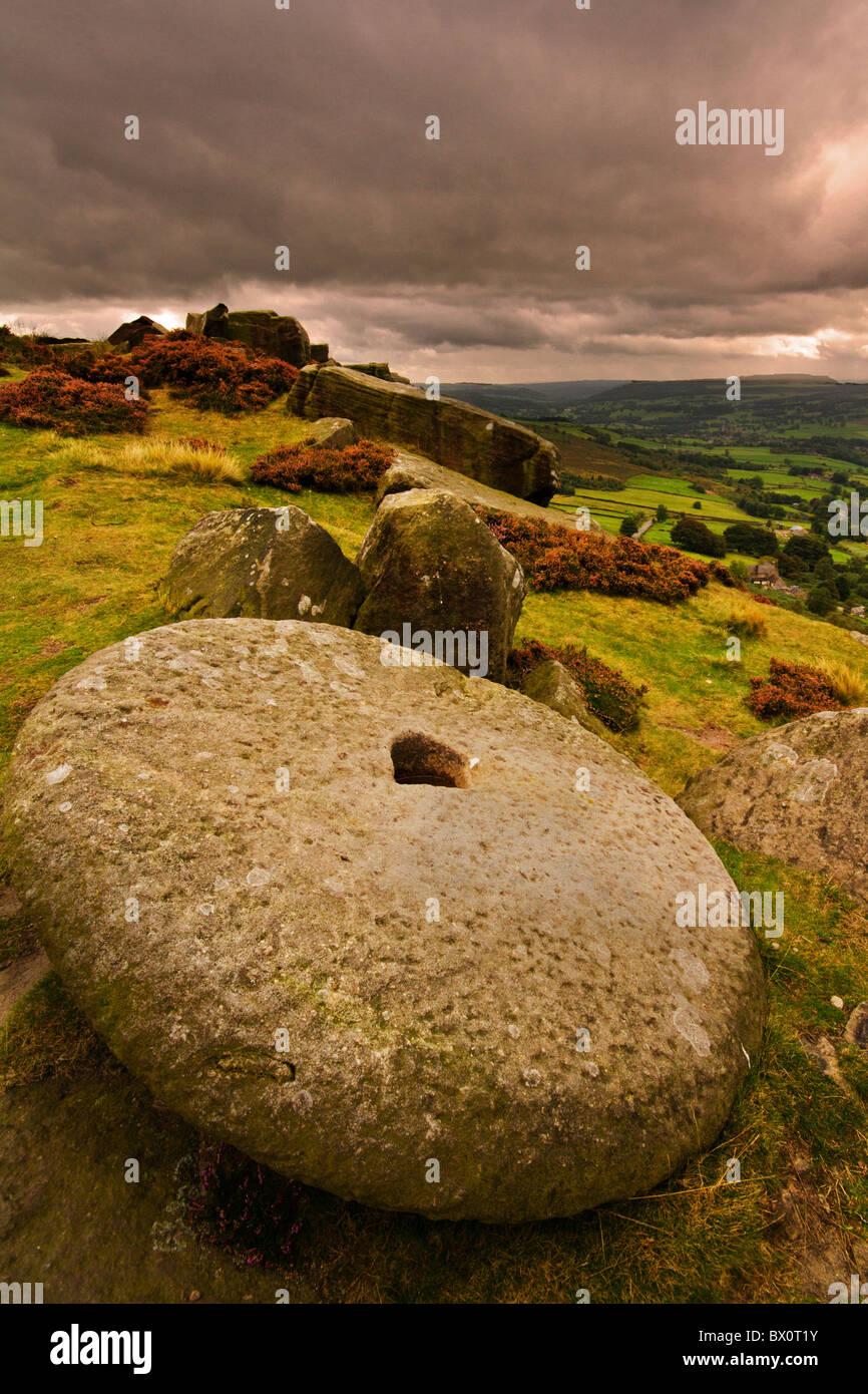 Millstone on the approach to Curbar Edge,Peak District National Park - Stock Image