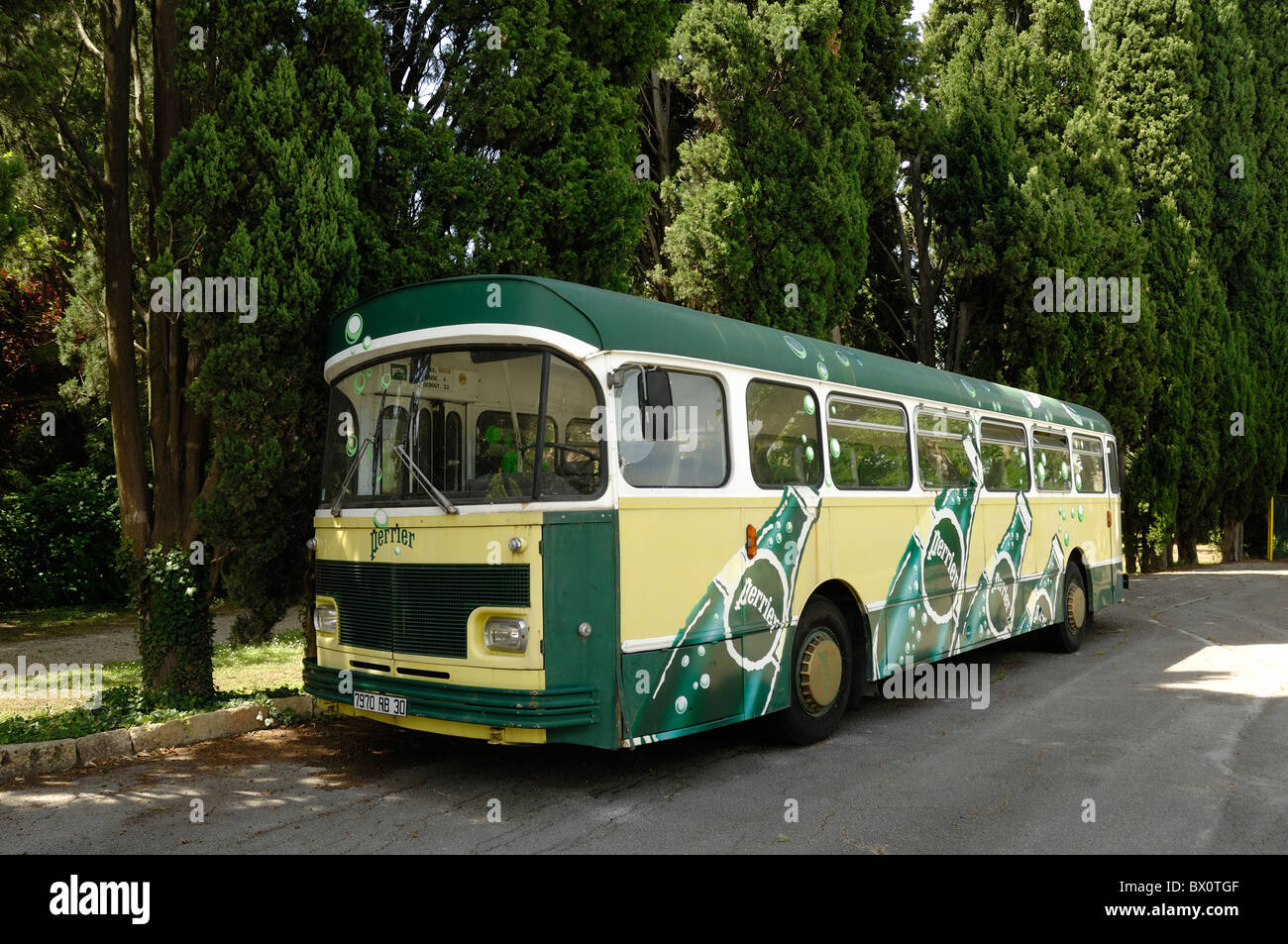 Painted Perrier Bus Decorated with Perrier Bottles for Advertising Purposes, Source Perrier, Vergèze, nr Nimes, - Stock Image