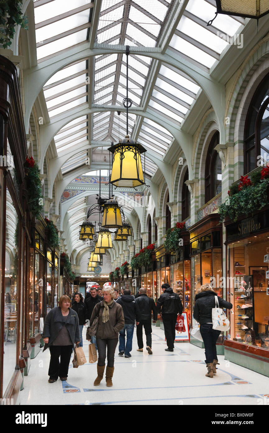 Royal Arcade, Norwich, Norfolk, England, UK. Shoppers in glass covered Victorian shopping precinct with traditional - Stock Image