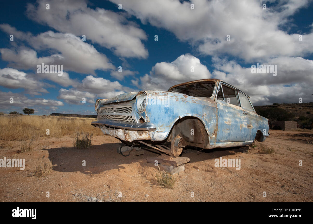 Old car on blocks in the desert, Namibia. - Stock Image