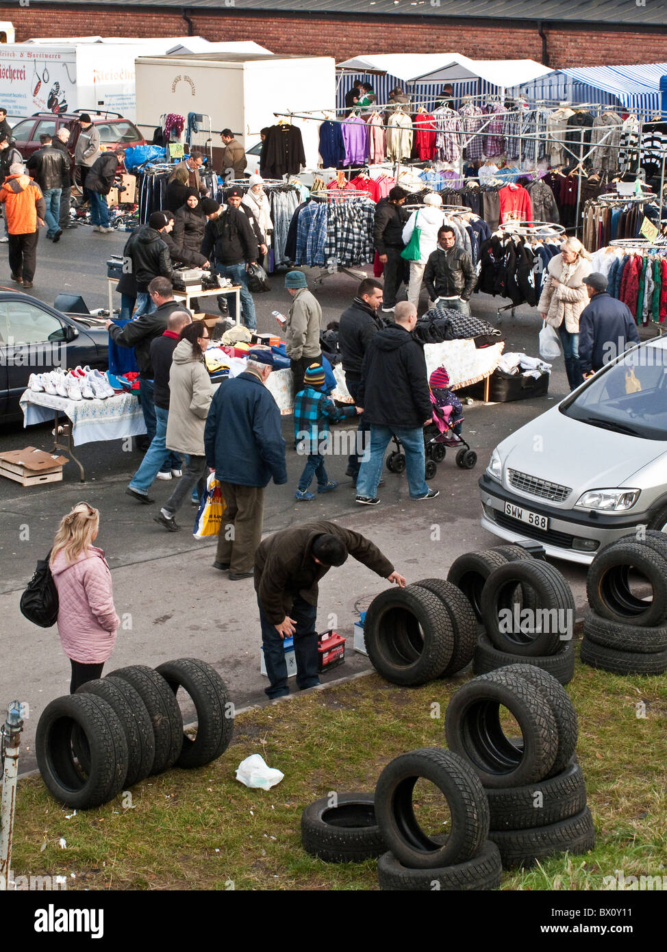 Second hand tires displayed at crowded weekend flea-market in outskirt of Gothenburg, Sweden - Stock Image
