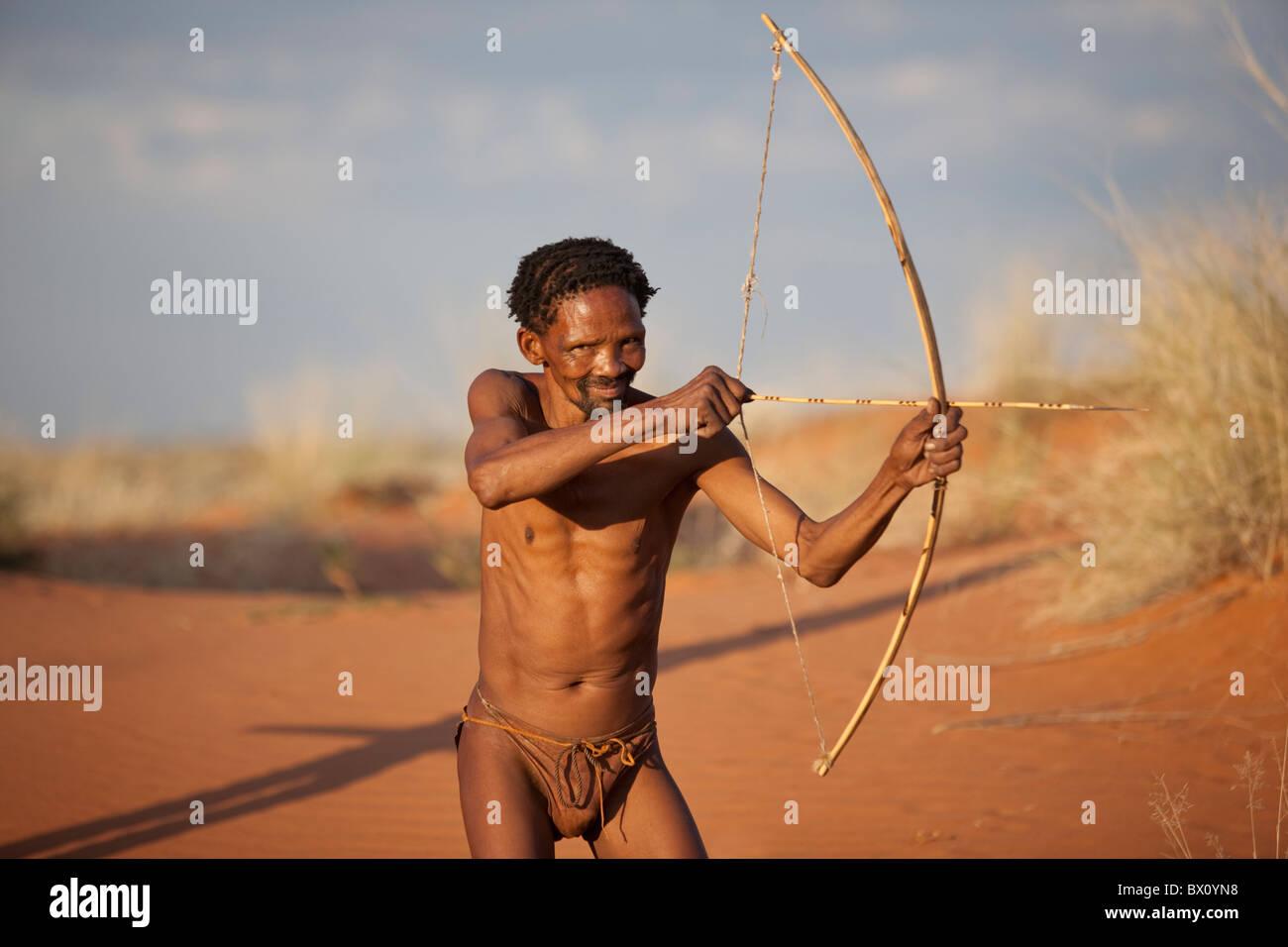 San Bushman on the Dunes of the Kalahari. - Stock Image