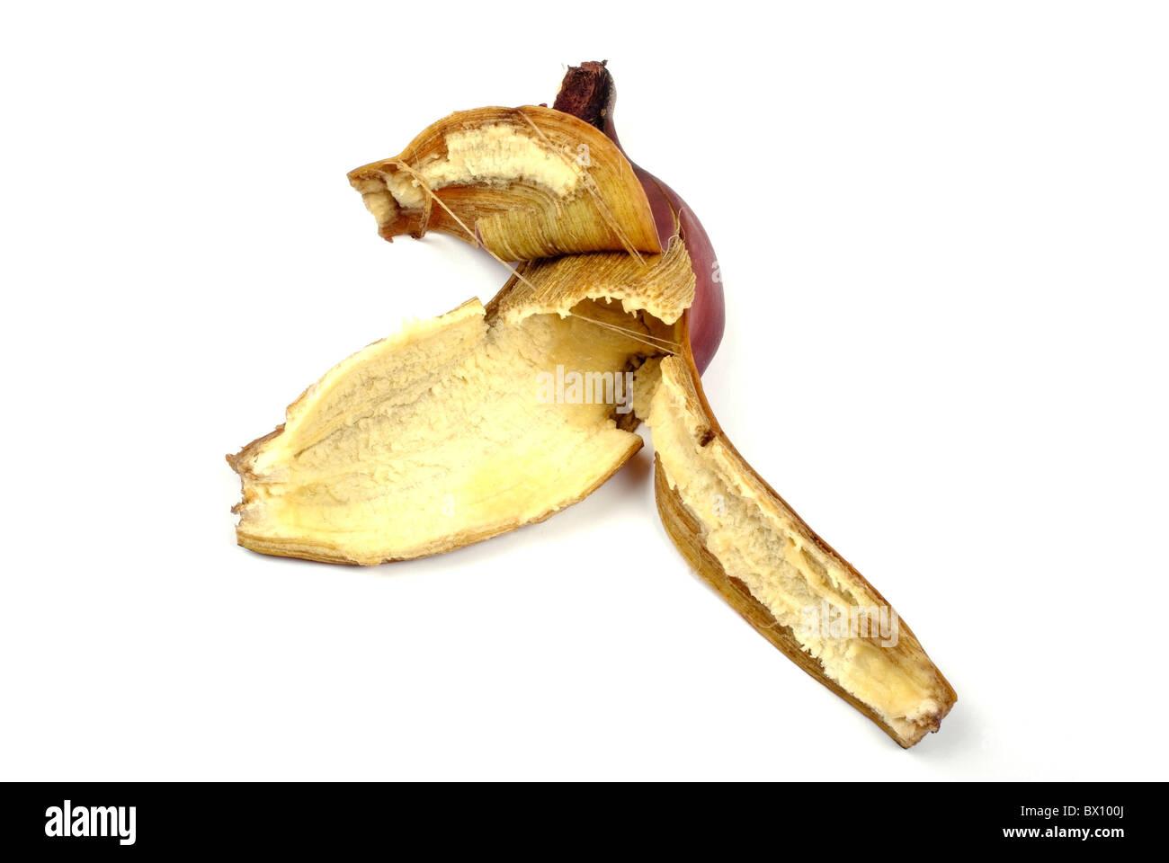Red banana peel isolated on white background. - Stock Image
