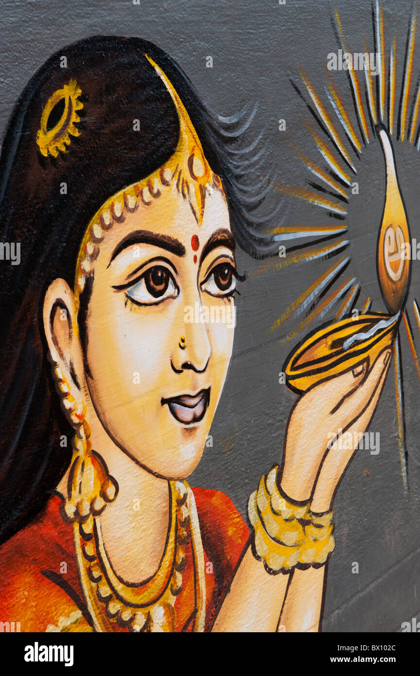 Traditional Indian painting of a Indian woman holding an oil lamp. Andhra Pradesh, India - Stock Image
