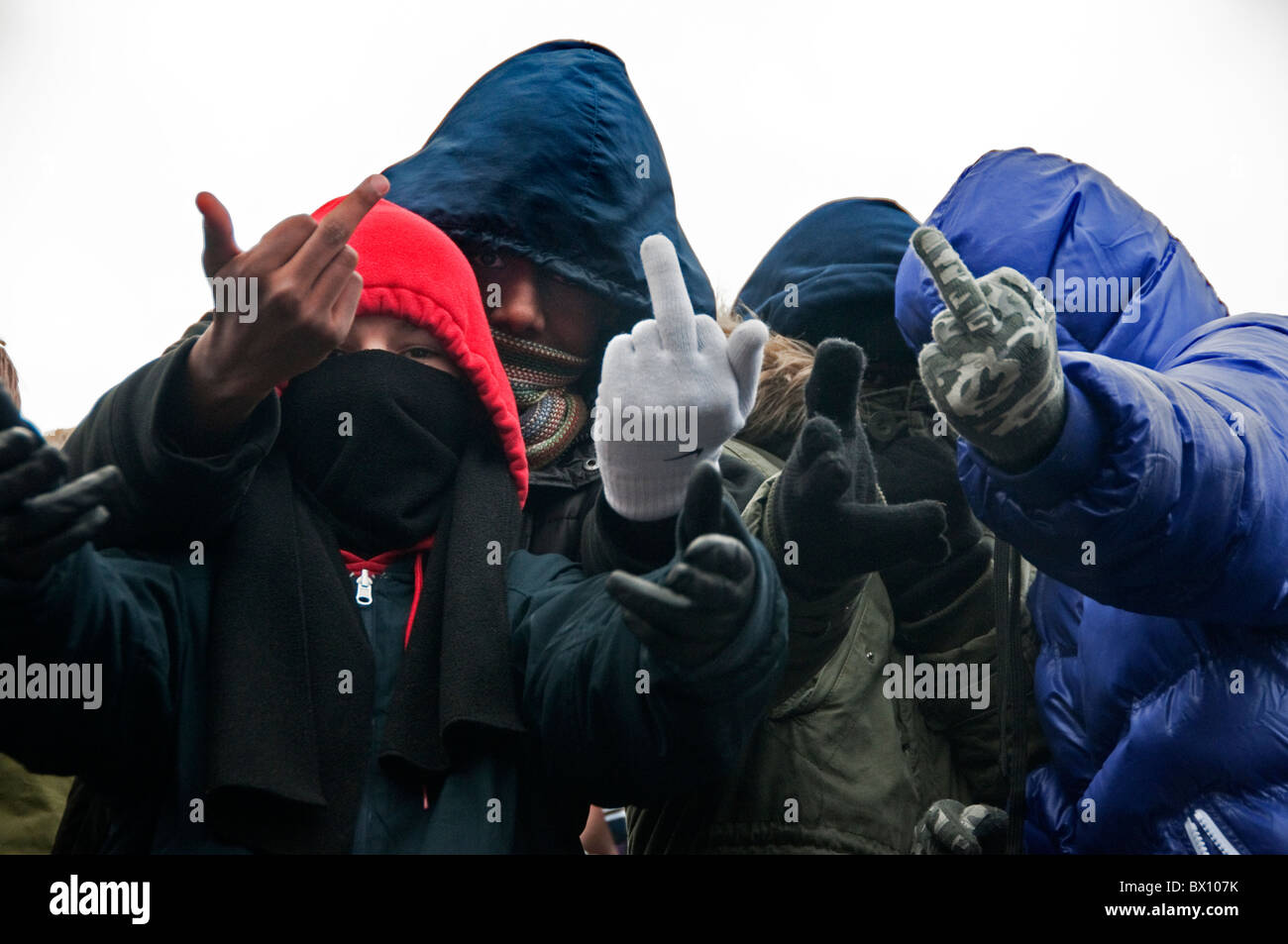 Group of young kids making rude gestures - Stock Image