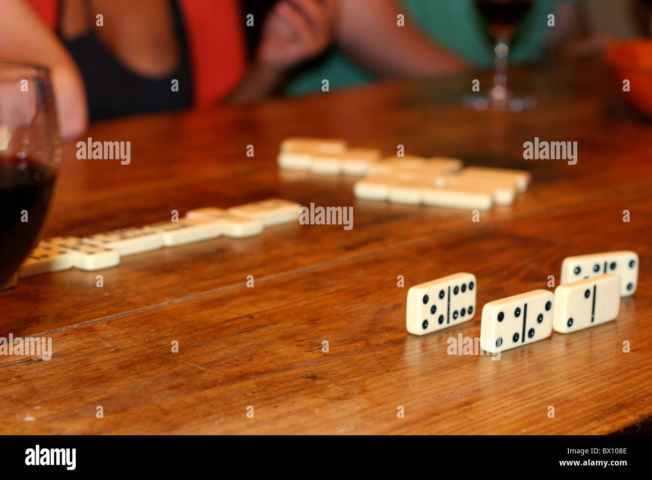 Domino's on wooden table - Stock Image