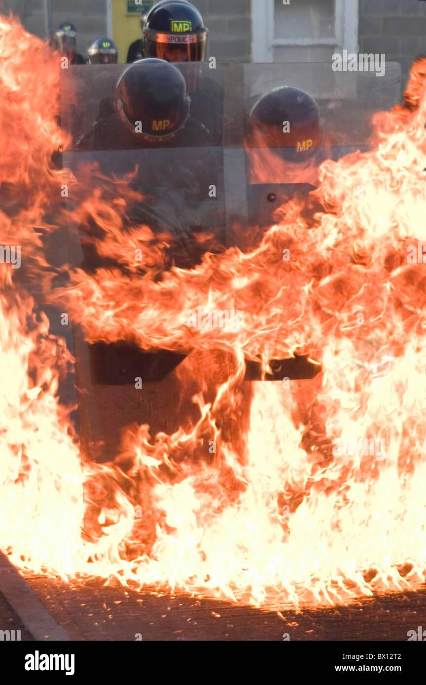 application demo demonstration fight fire flames Metropolitan police model released Molotov cocktail operat - Stock Image