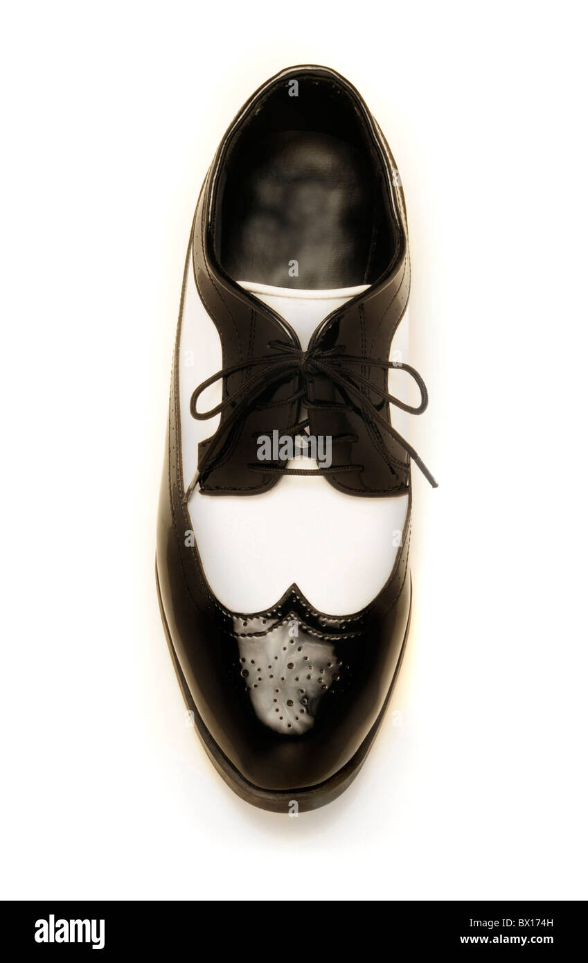 Two-tone black and white patent leather men's shoe on white - Stock Image