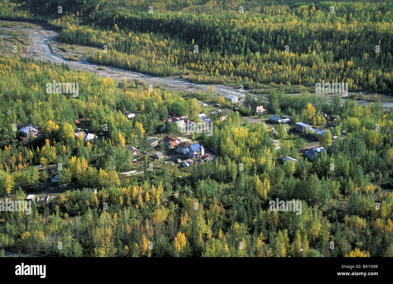 Aerial view from town Alaska McCarthy USA America United States forest village river houses autumn lands - Stock Image