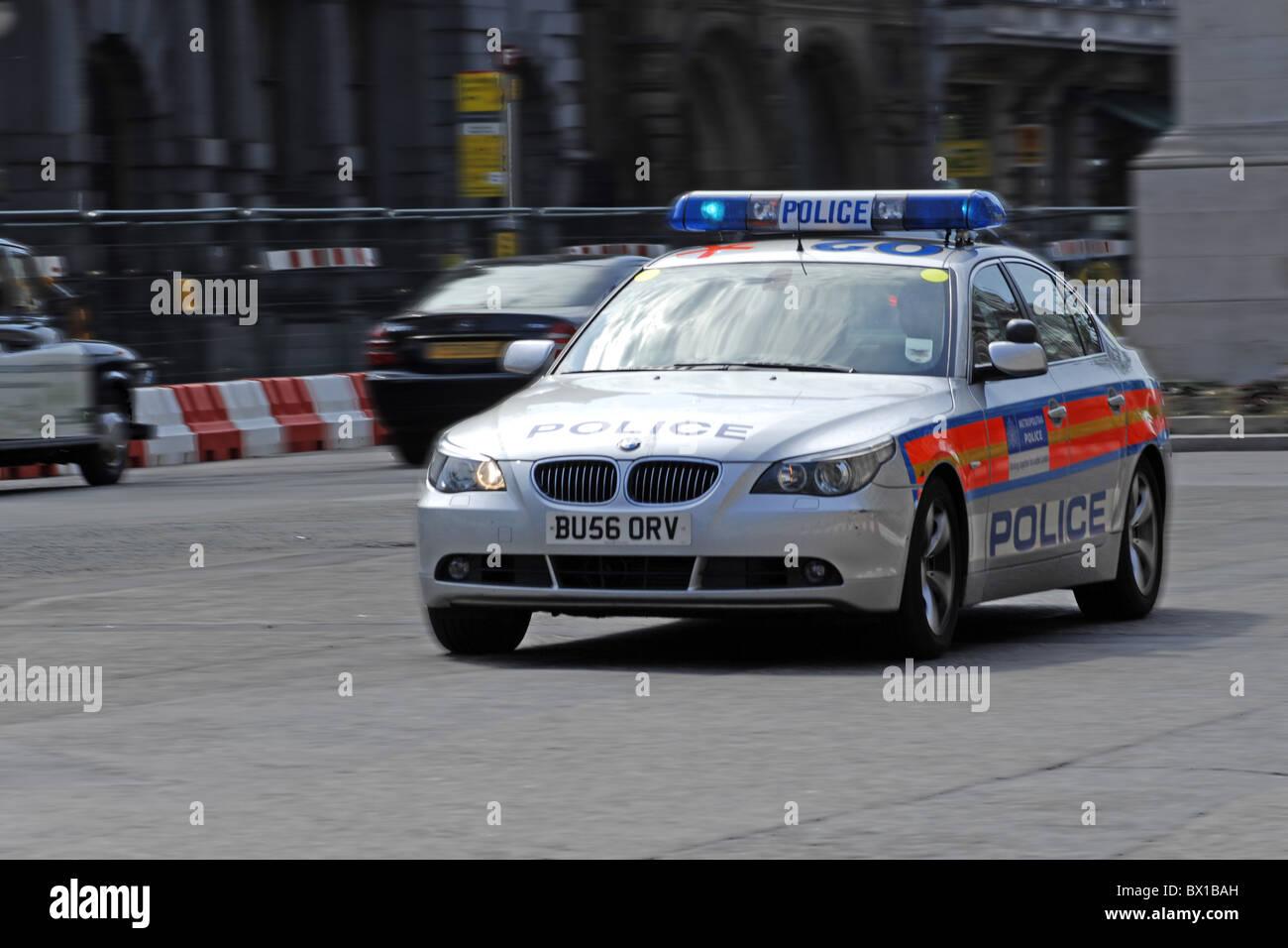 Police vehicle speeding through the streets of London Stock Photo