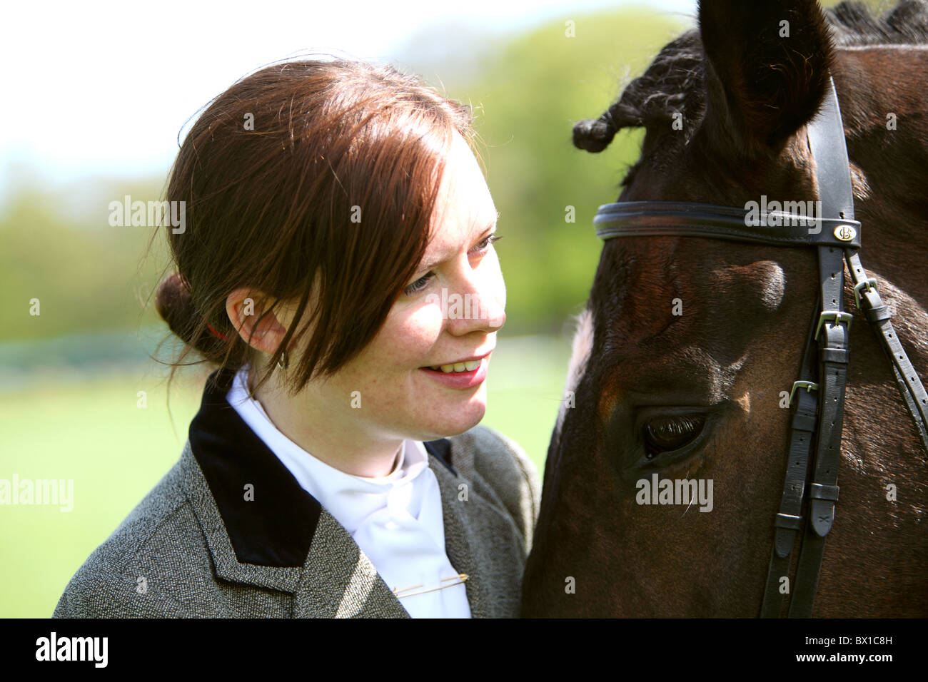 rider and horse Scotland UK head to head touching - Stock Image