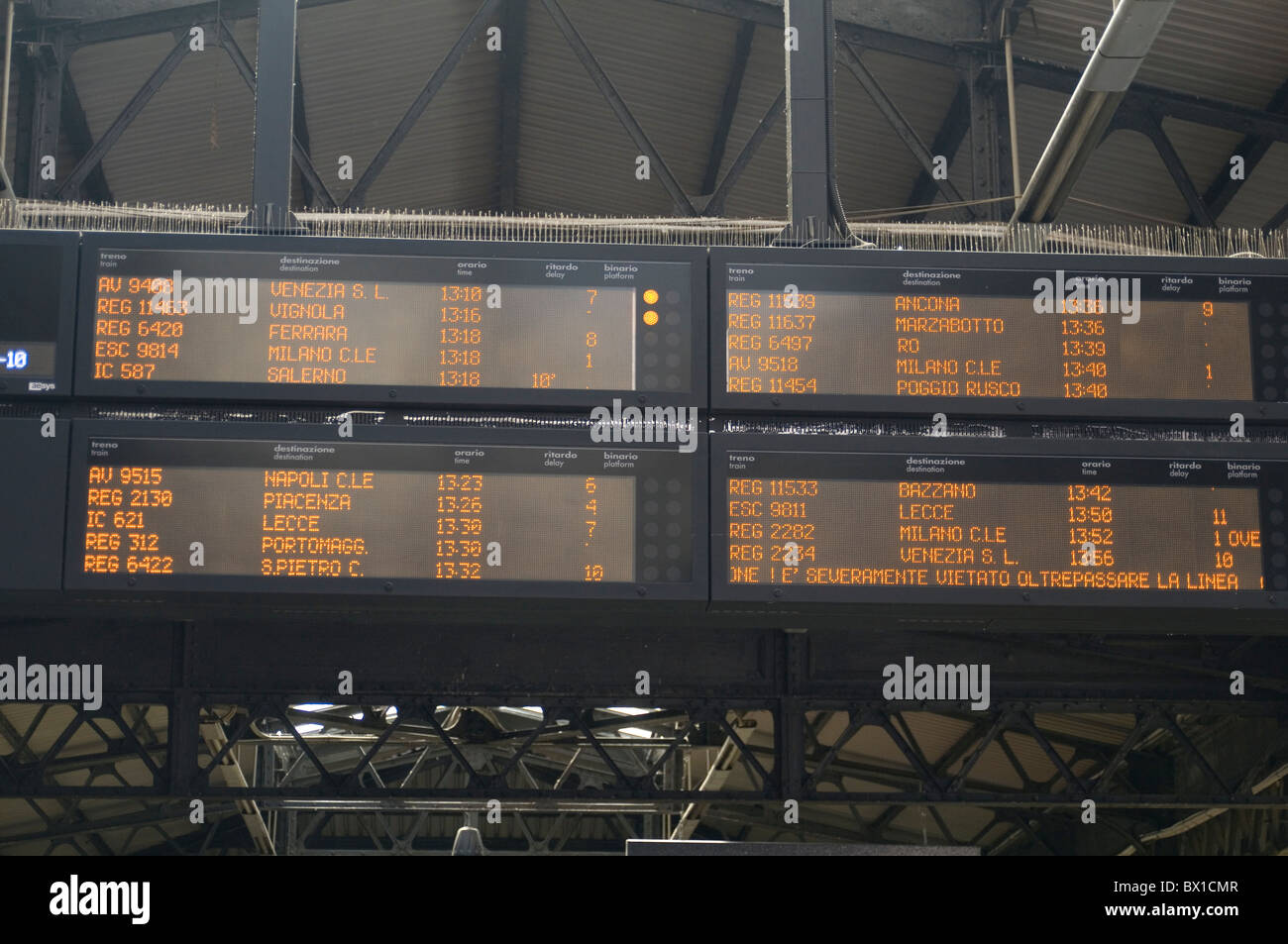train departure arrival information timetable timetables time table tables station arrivals departures on time late - Stock Image