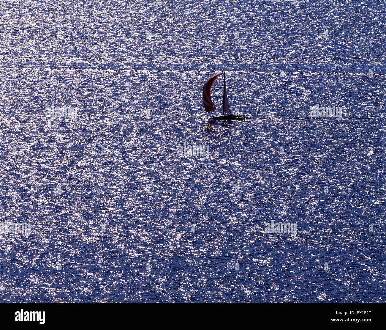 Sail boat lake to shining Boat sails spare time - Stock Image