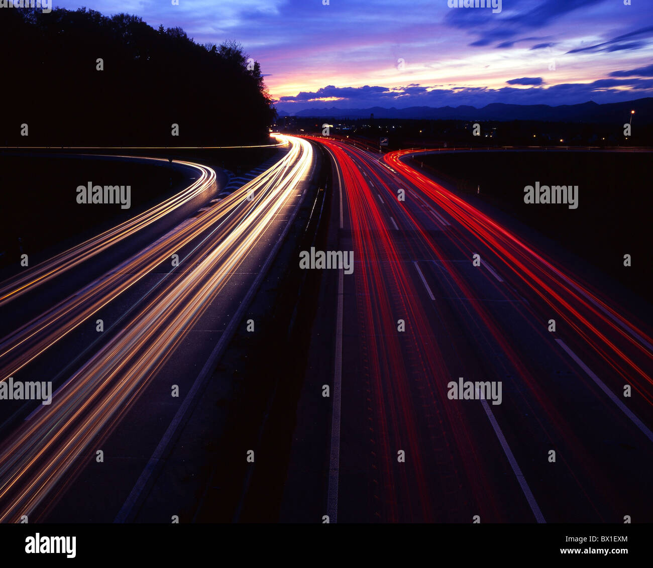 Highway lights light stripes A1 near spring castle canton Aargau Switzerland Europe at night night traffic - Stock Image