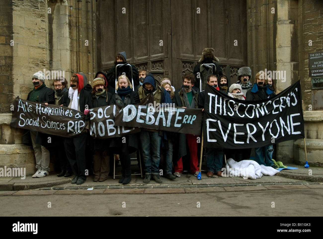 Cambridge University students staging a silent protest against the planned increase in tuition fees - Stock Image