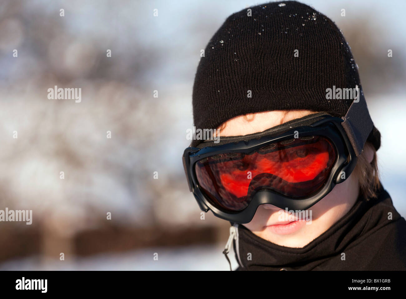 Closeup of the teenager with ski goggles. - Stock Image