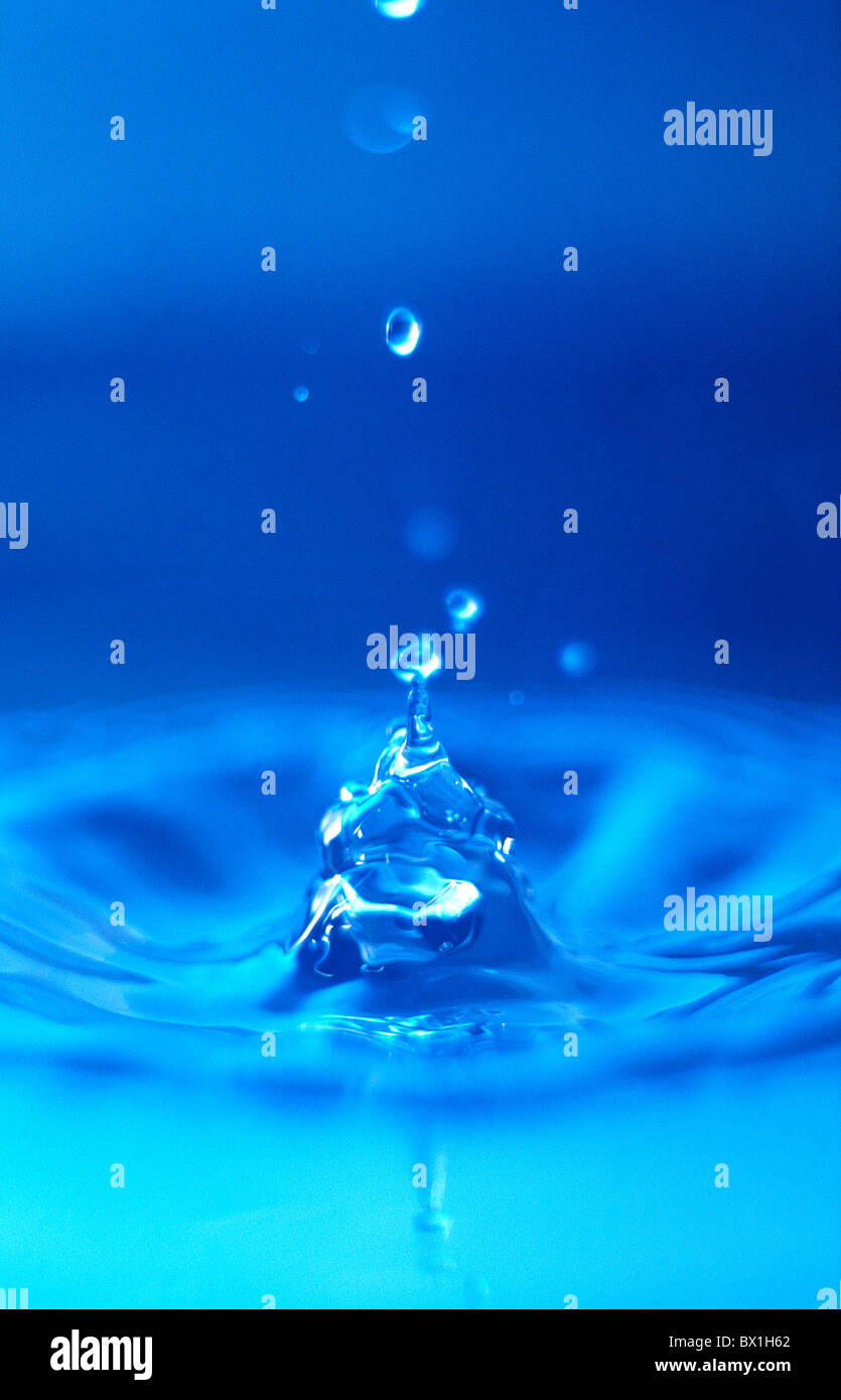 water droplet splashing into water background backgrounds blue color colour concept concepts detail detai