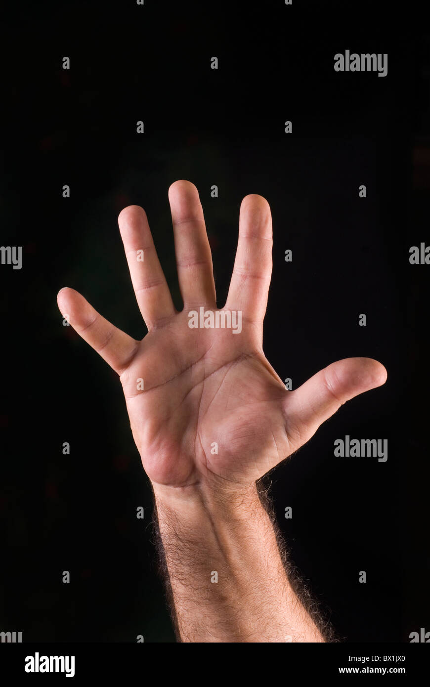 Hand of man showing a stop gesture - Stock Image