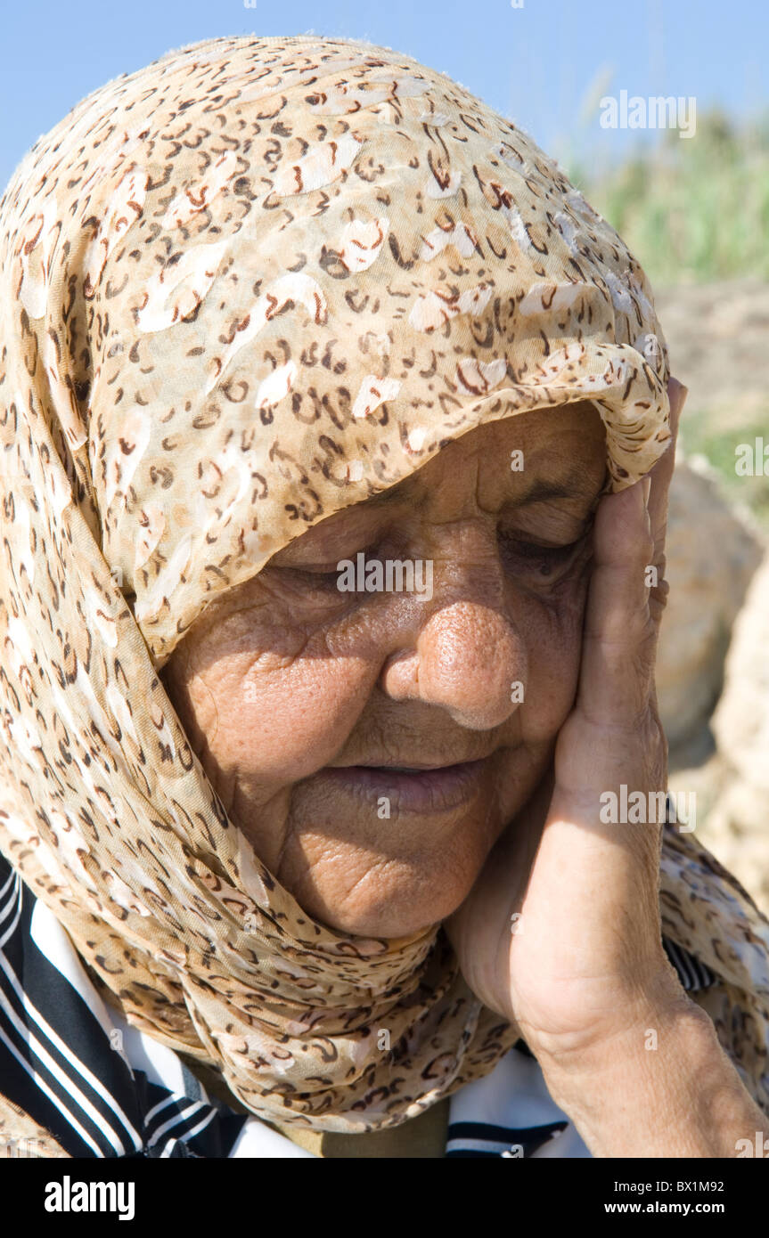 Closeup of a 75 years old Palestinian refugee woman head in hands in Tyr Lebanon Middle East - Stock Image